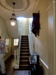 The hallway on entering, with its teeny tiny stairs.